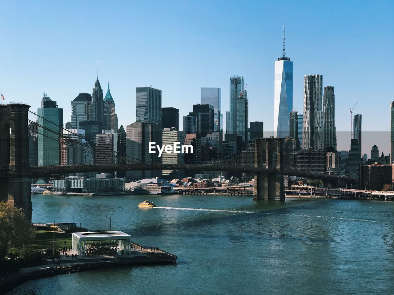 Brooklyn Bridge And East River Against Sky In City
