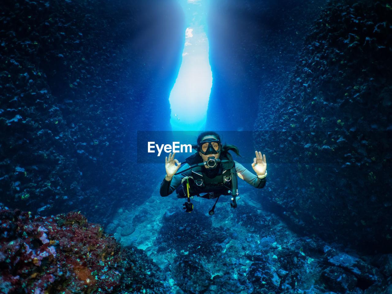 Portrait of woman scuba diving in sea