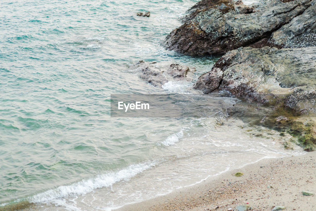 sea, water, motion, land, beach, wave, beauty in nature, sport, aquatic sport, surfing, day, nature, rock, scenics - nature, outdoors, rock - object, solid, sand, power in nature