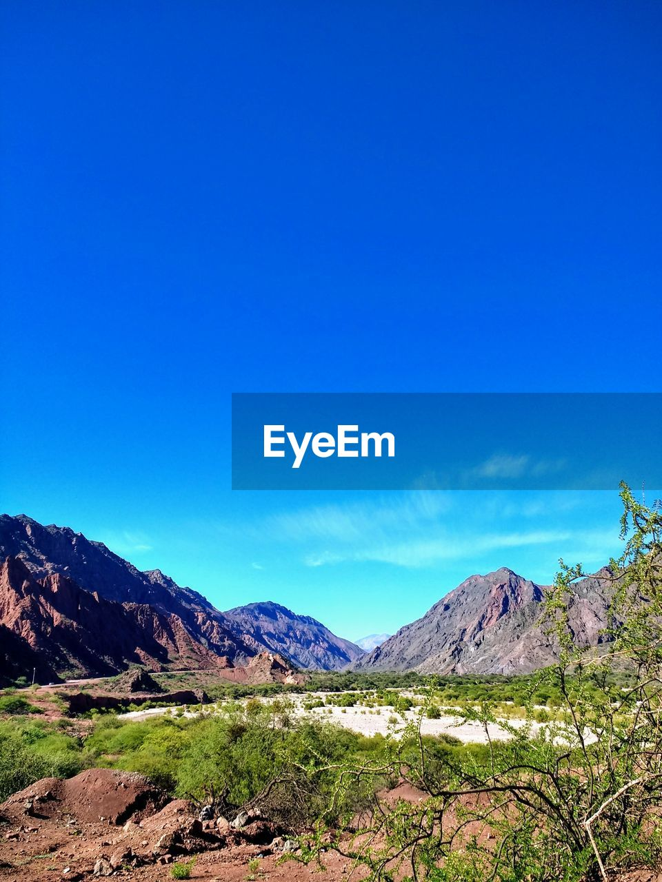 mountain, scenics - nature, sky, beauty in nature, blue, tranquility, tranquil scene, copy space, landscape, environment, non-urban scene, mountain range, idyllic, nature, clear sky, no people, day, remote, land, sunlight, mountain peak