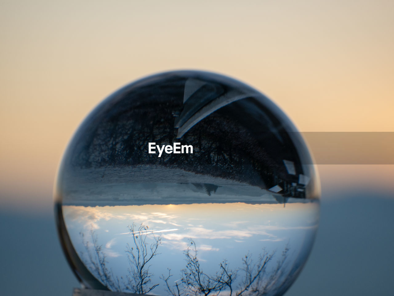 close-up, nature, glass - material, no people, focus on foreground, sky, transparent, reflection, sphere, sunset, still life, crystal ball, outdoors, shape, orange color, copy space, single object, design, geometric shape