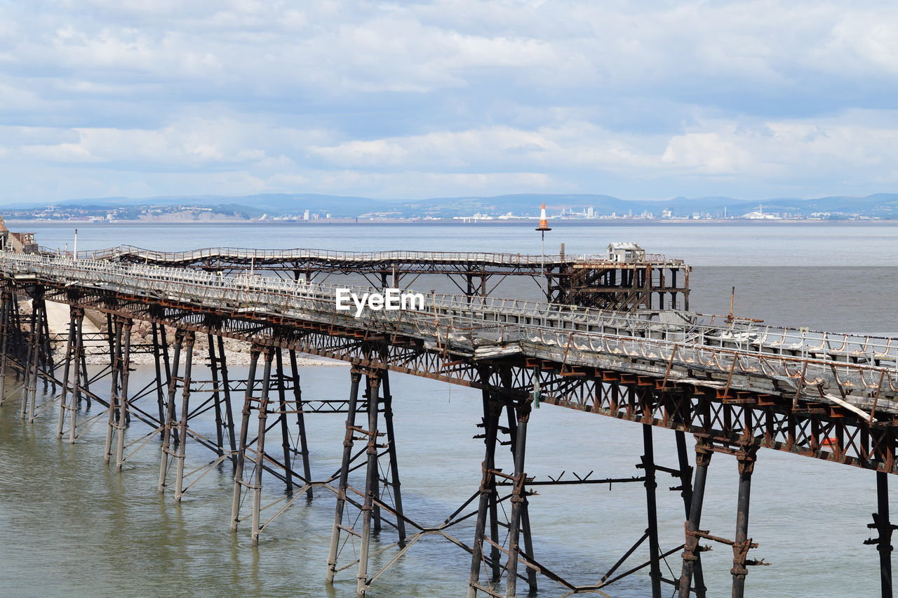 water, sky, cloud - sky, built structure, architecture, sea, nature, pier, connection, scenics - nature, no people, building exterior, day, outdoors, beauty in nature, waterfront, transportation, tranquil scene, bridge