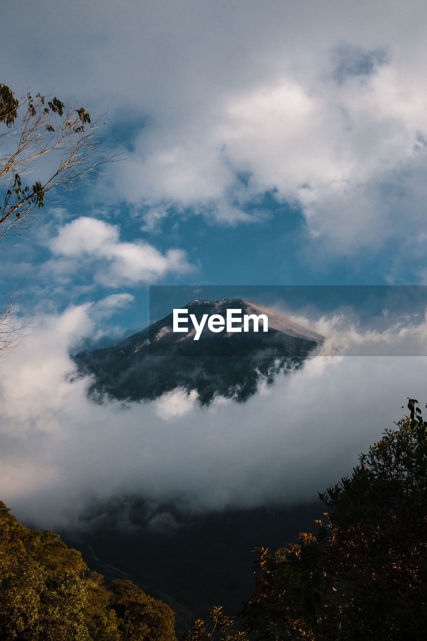 cloud - sky, beauty in nature, sky, mountain, scenics - nature, non-urban scene, tranquil scene, nature, no people, plant, tranquility, tree, volcano, environment, idyllic, day, geology, land, travel destinations, outdoors, mountain peak, power in nature, volcanic crater