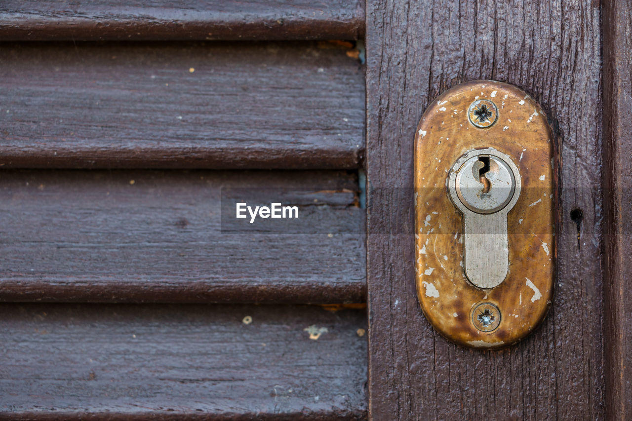 door, wood - material, entrance, protection, metal, security, close-up, old, safety, no people, backgrounds, lock, weathered, day, closed, pattern, full frame, handle, rusty, outdoors, latch