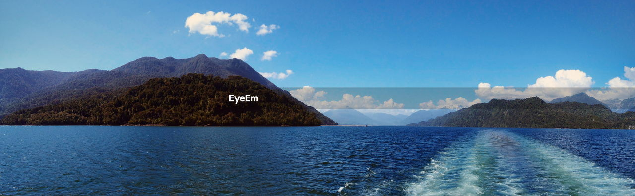 PANORAMIC VIEW OF LAKE AGAINST BLUE SKY