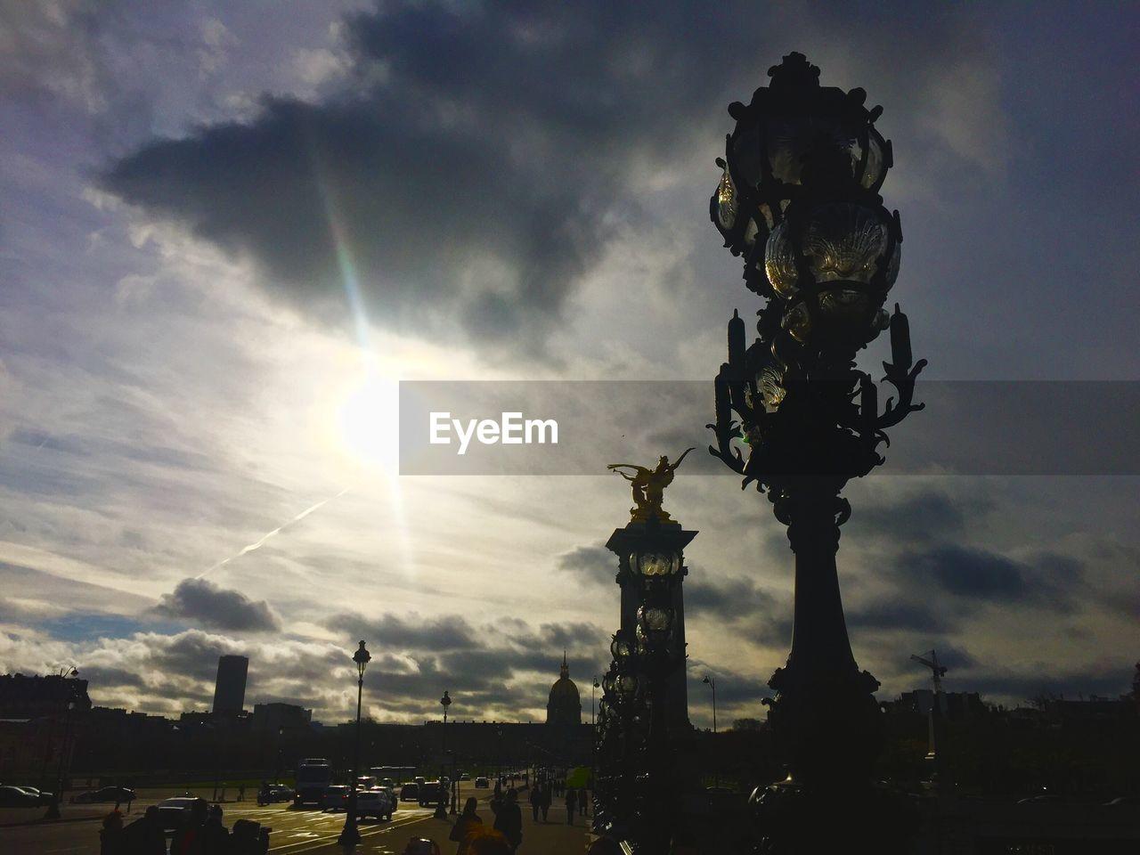 sun, sky, sunbeam, cloud - sky, statue, sunlight, no people, silhouette, outdoors, sculpture, sunset, nature, architecture, day