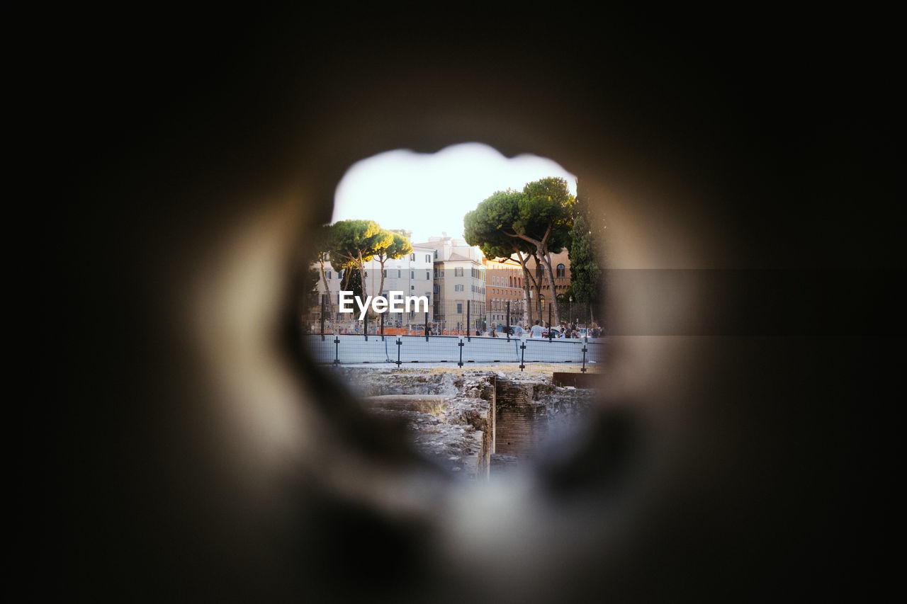 Street view shot through hole in wall