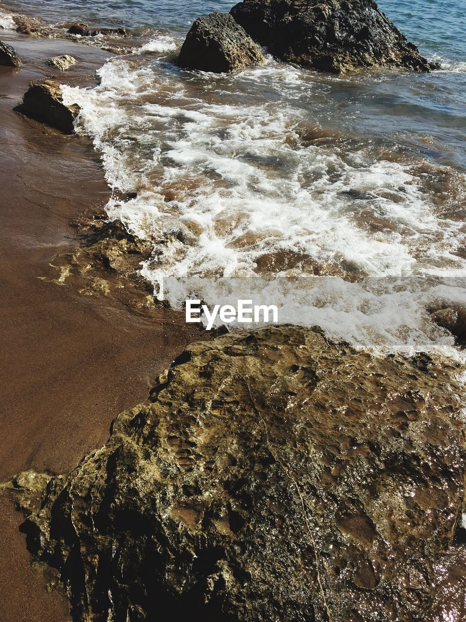 sea, water, beach, nature, wave, shore, beauty in nature, rock - object, tranquility, no people, tranquil scene, day, sand, outdoors, scenics