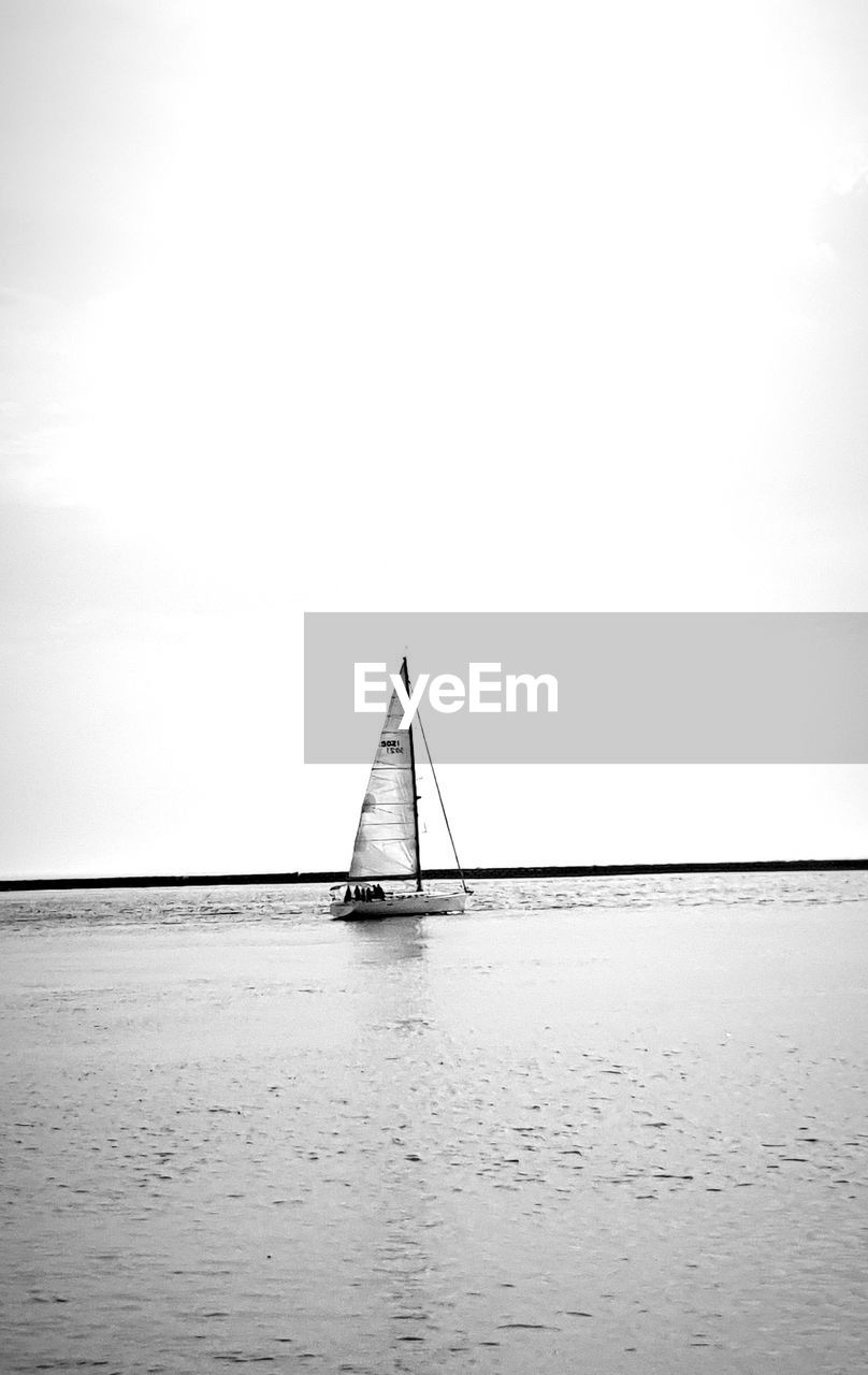 water, sky, sea, transportation, waterfront, day, scenics - nature, nature, nautical vessel, horizon over water, copy space, horizon, tranquil scene, tranquility, no people, sailboat, mode of transportation, beauty in nature, built structure, outdoors