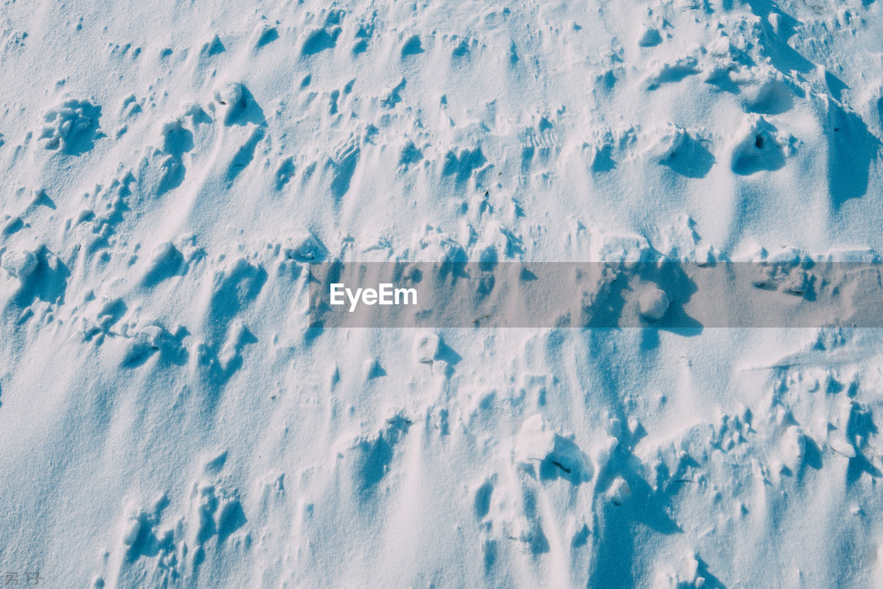 snow, winter, cold temperature, white color, nature, beauty in nature, day, no people, land, covering, full frame, high angle view, backgrounds, sport, field, outdoors, scenics - nature, close-up, tranquility, powder snow