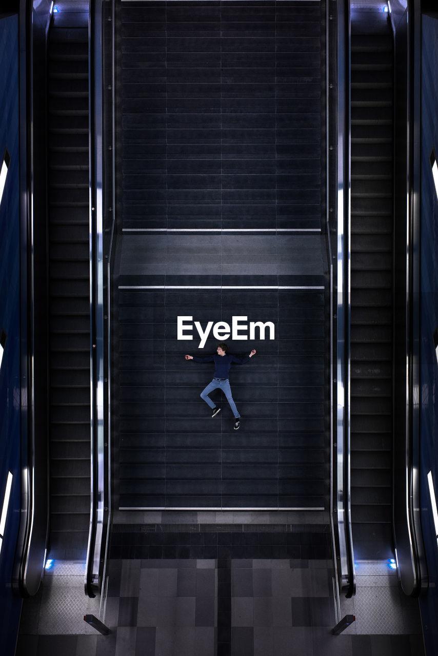 Man lying down on steps
