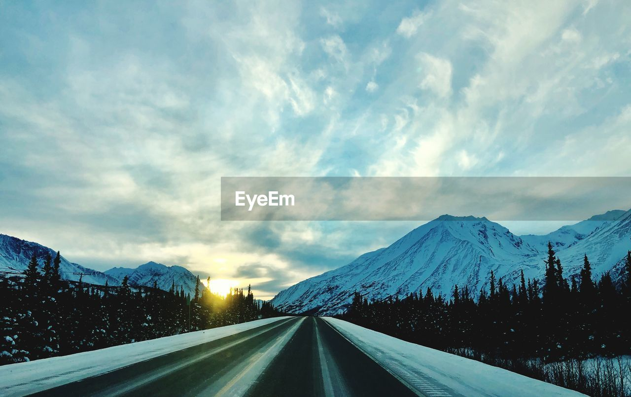 sky, snow, cloud - sky, winter, cold temperature, mountain, transportation, beauty in nature, nature, scenics - nature, no people, the way forward, road, tranquil scene, direction, snowcapped mountain, diminishing perspective, mountain range, tranquility, outdoors