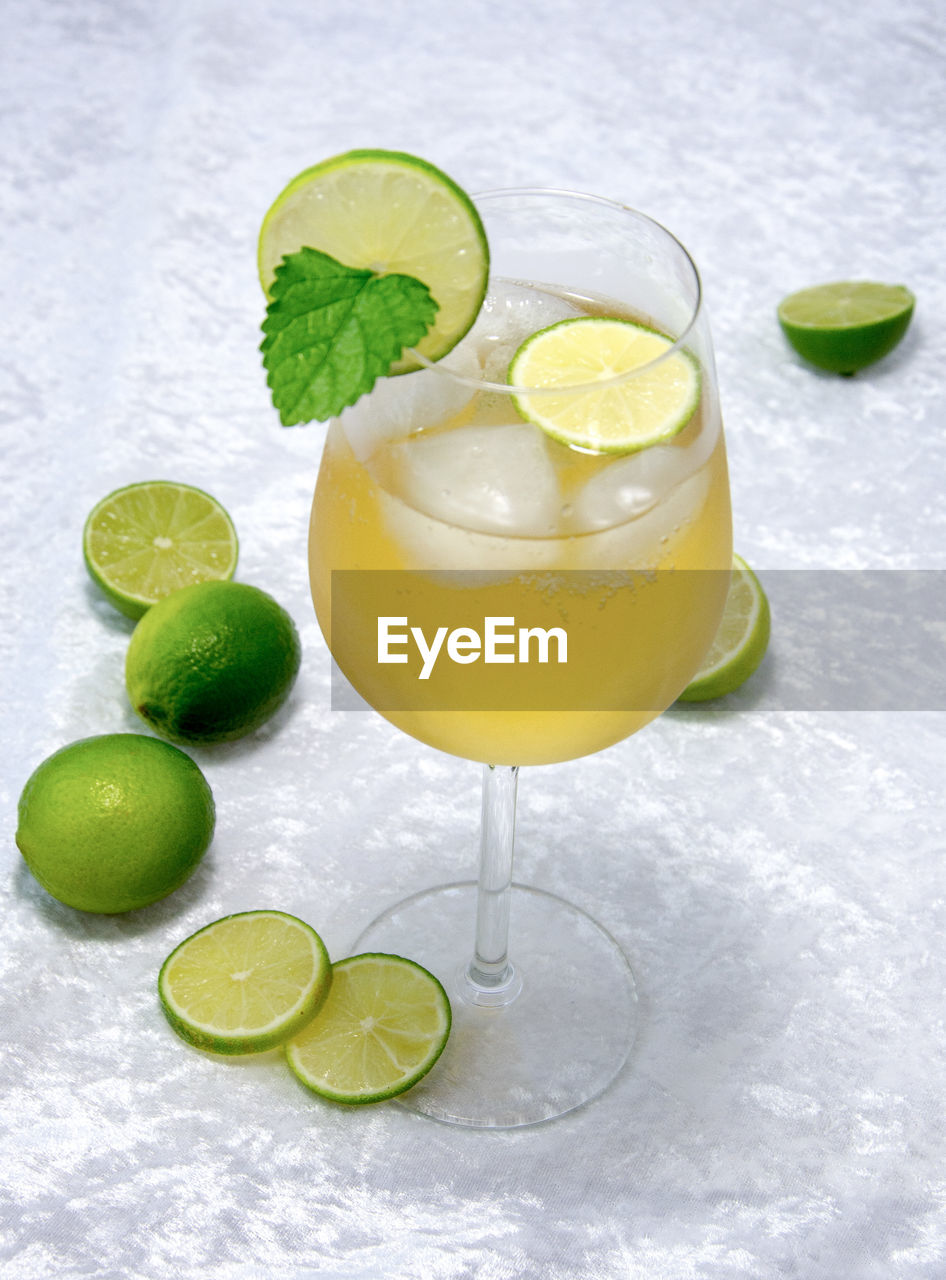 refreshment, food and drink, citrus fruit, drink, alcohol, fruit, cocktail, glass, food, drinking glass, slice, lime, freshness, cold temperature, healthy eating, no people, lemon, household equipment, leaf, mint leaf - culinary, ice, tropical drink, herb, mojito, garnish, temptation