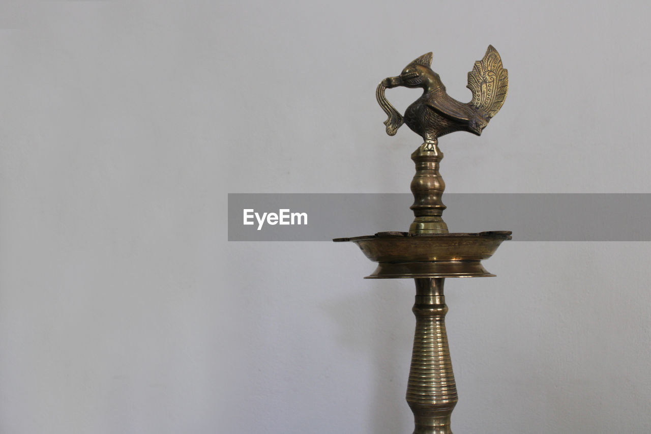 Close-up of lamp against white background