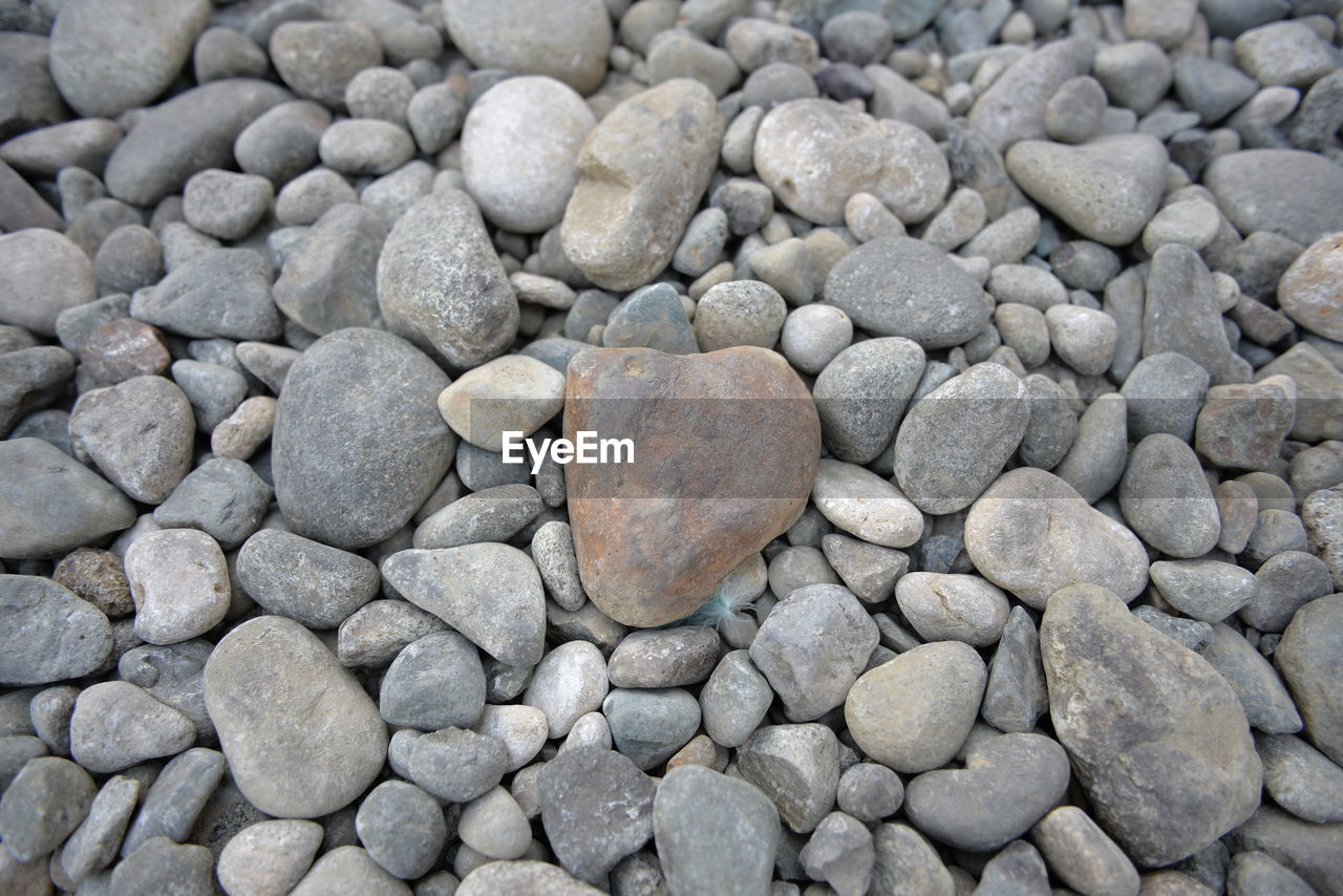 rock, solid, stone, pebble, stone - object, full frame, large group of objects, no people, backgrounds, gray, rock - object, textured, abundance, high angle view, day, nature, close-up, heart shape, outdoors, shape, gravel, textured effect