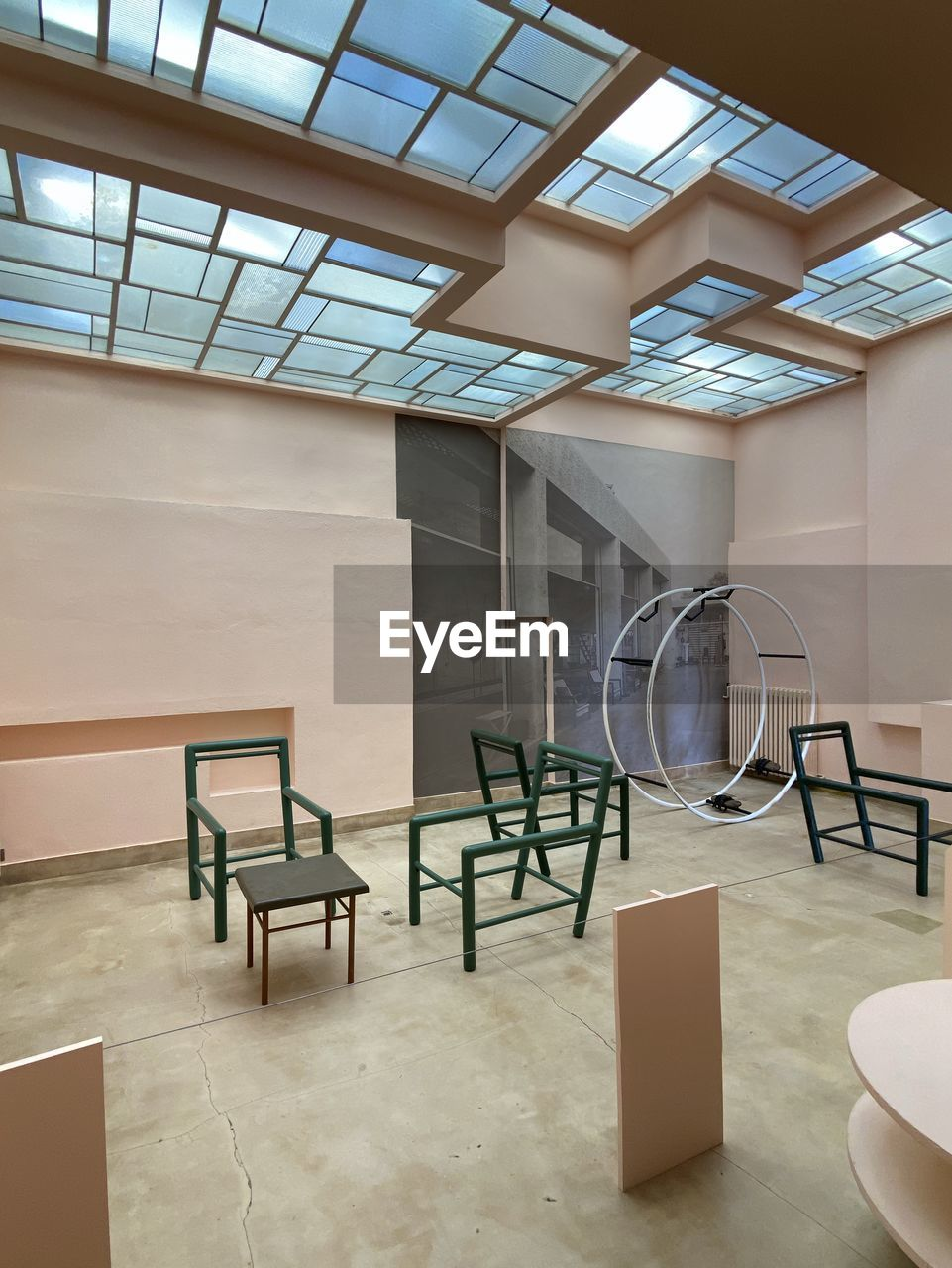 indoors, seat, absence, table, architecture, no people, empty, chair, built structure, flooring, business, day, furniture, modern, office, staircase, wall - building feature, home interior, window, wood - material, ceiling, luxury
