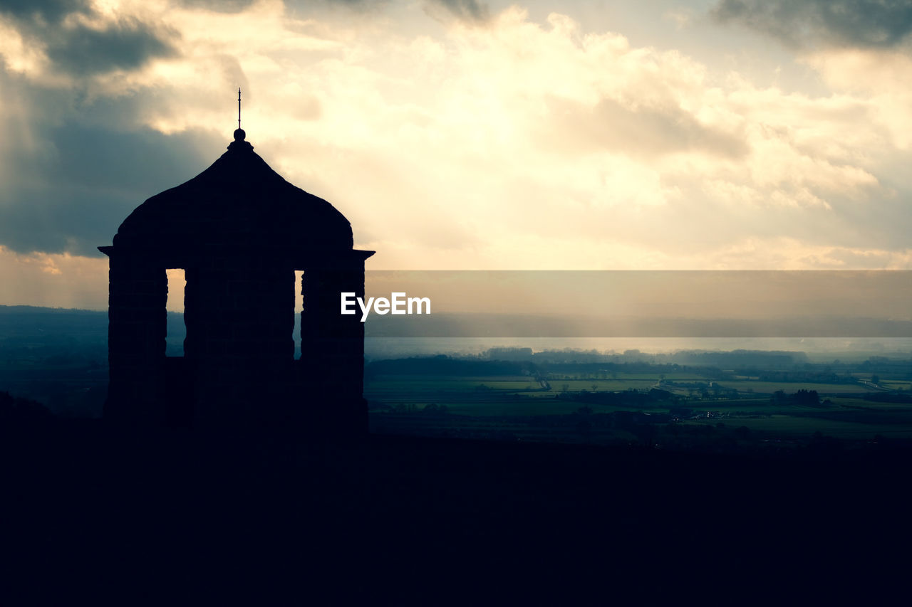 religion, spirituality, silhouette, sky, cloud - sky, architecture, built structure, place of worship, building exterior, no people, history, sunset, beauty in nature, outdoors, bell tower, nature, day