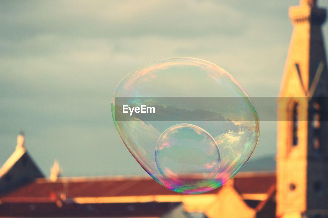 Big bubble against cloudy sky