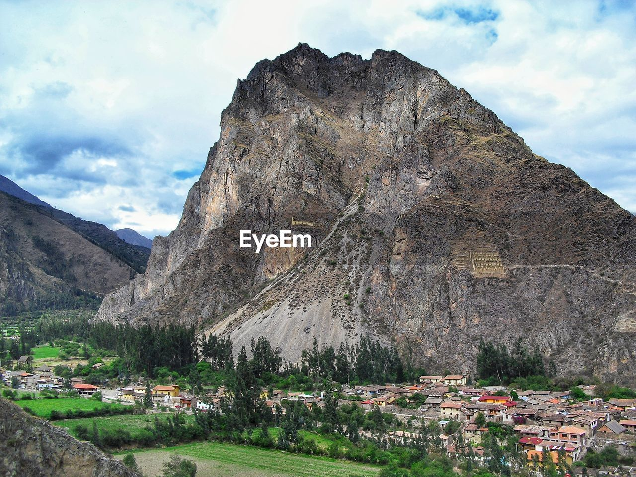 mountain, sky, cloud - sky, architecture, built structure, building exterior, nature, mountain range, day, building, beauty in nature, no people, scenics - nature, travel, environment, travel destinations, rock formation, plant, outdoors, rock, formation, mountain peak