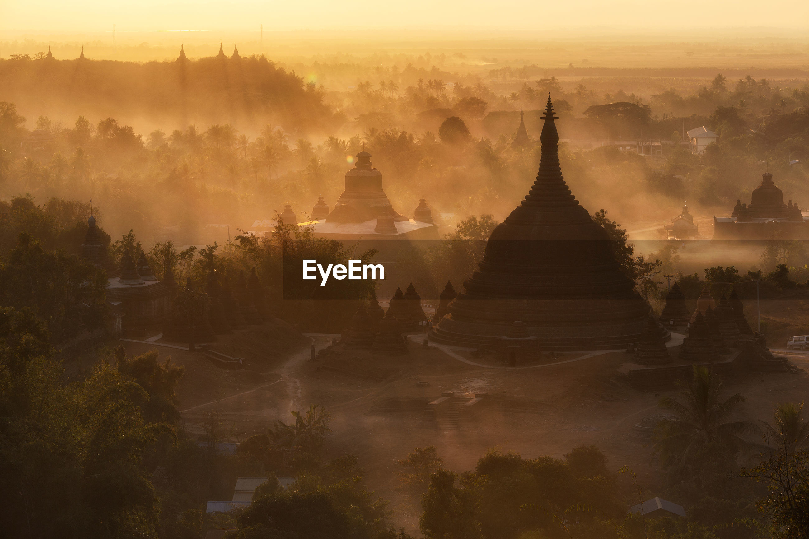 High angle view of temple against sky during sunrise