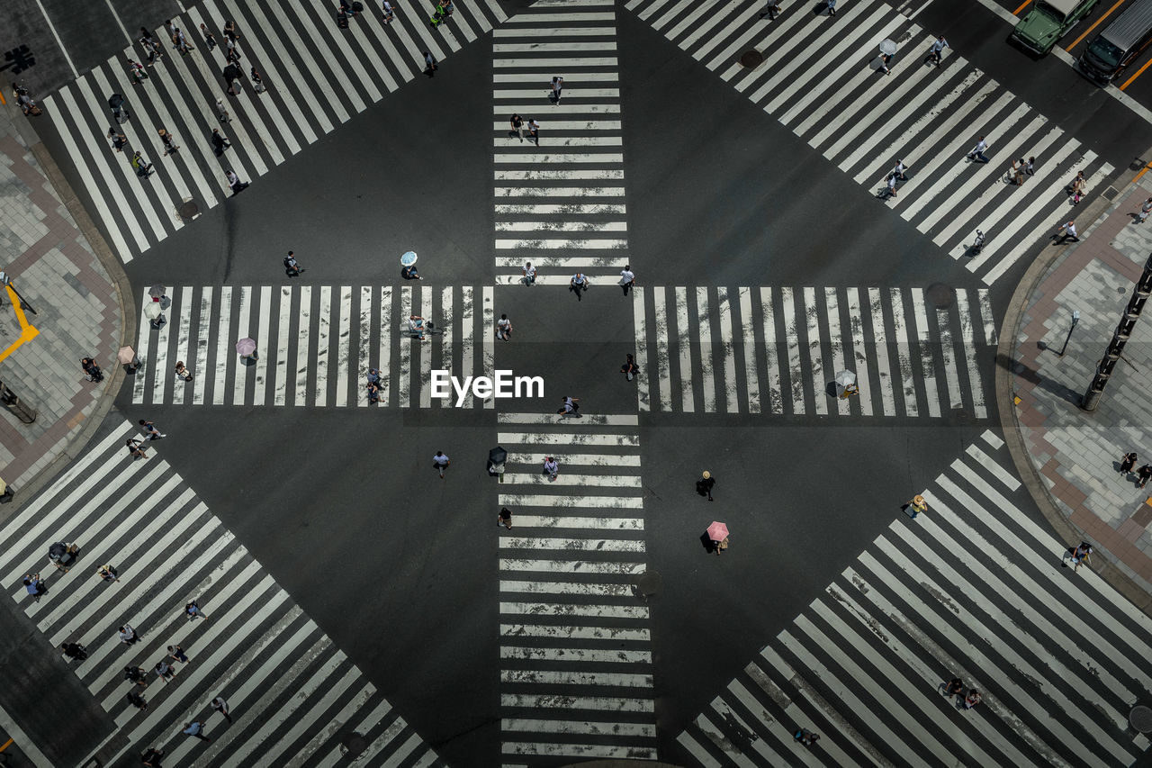 High Angle View Of Crowd Crossing Road In City