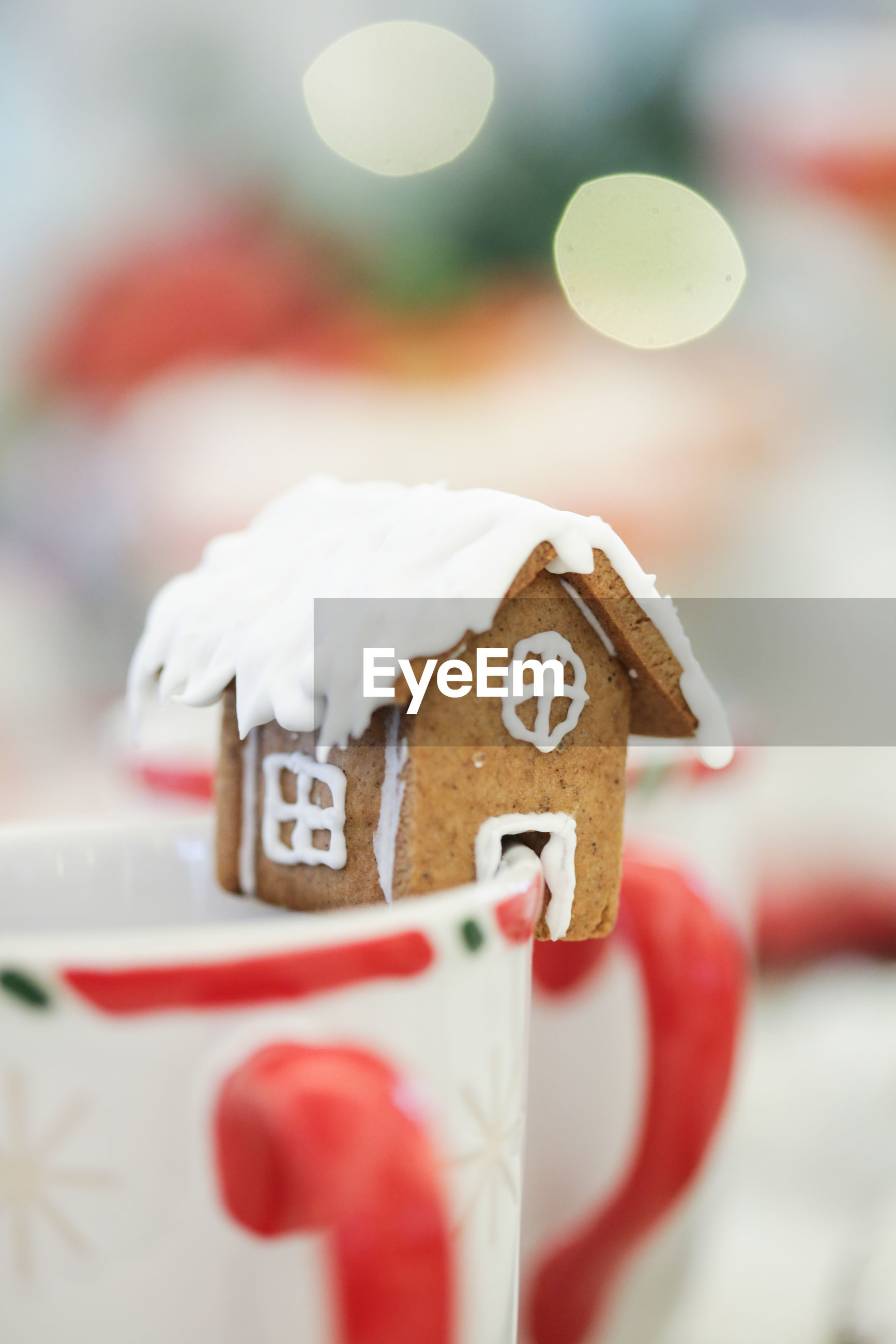Close-up of gingerbread house on mug during christmas