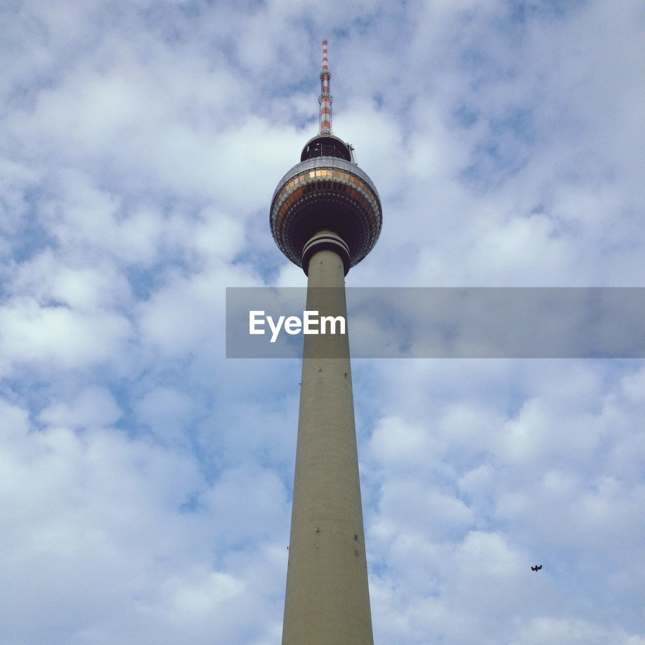 Low Angle View Of Fernsehturm Against Cloudy Sky