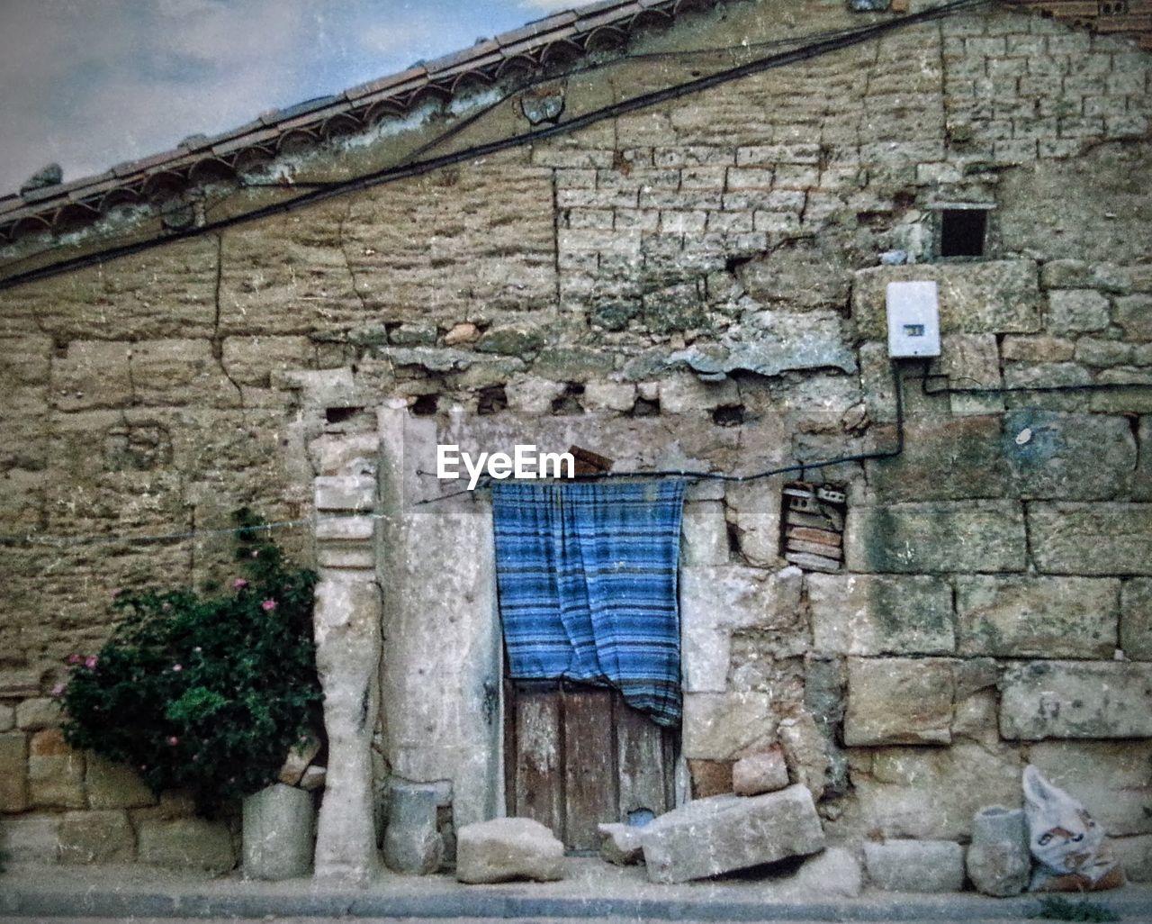 Stone Wall House Against Sky