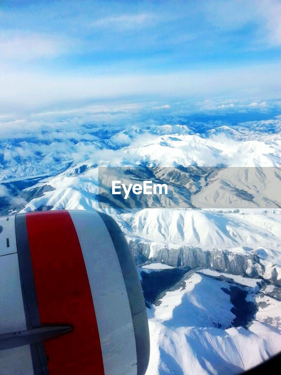 aerial view, winter, snow, cold temperature, nature, airplane, beauty in nature, no people, scenics, white color, transportation, day, weather, snowcapped mountain, air vehicle, outdoors, tranquil scene, tranquility, sky, landscape, airplane wing, flying, close-up