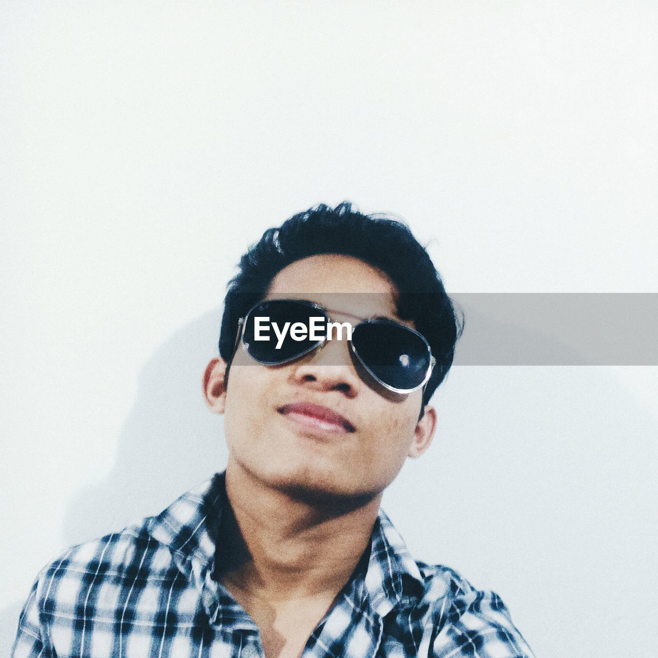 sunglasses, real people, one person, young adult, portrait, front view, casual clothing, young men, lifestyles, looking at camera, white background, eyeglasses, eyewear, technology, day, close-up, outdoors