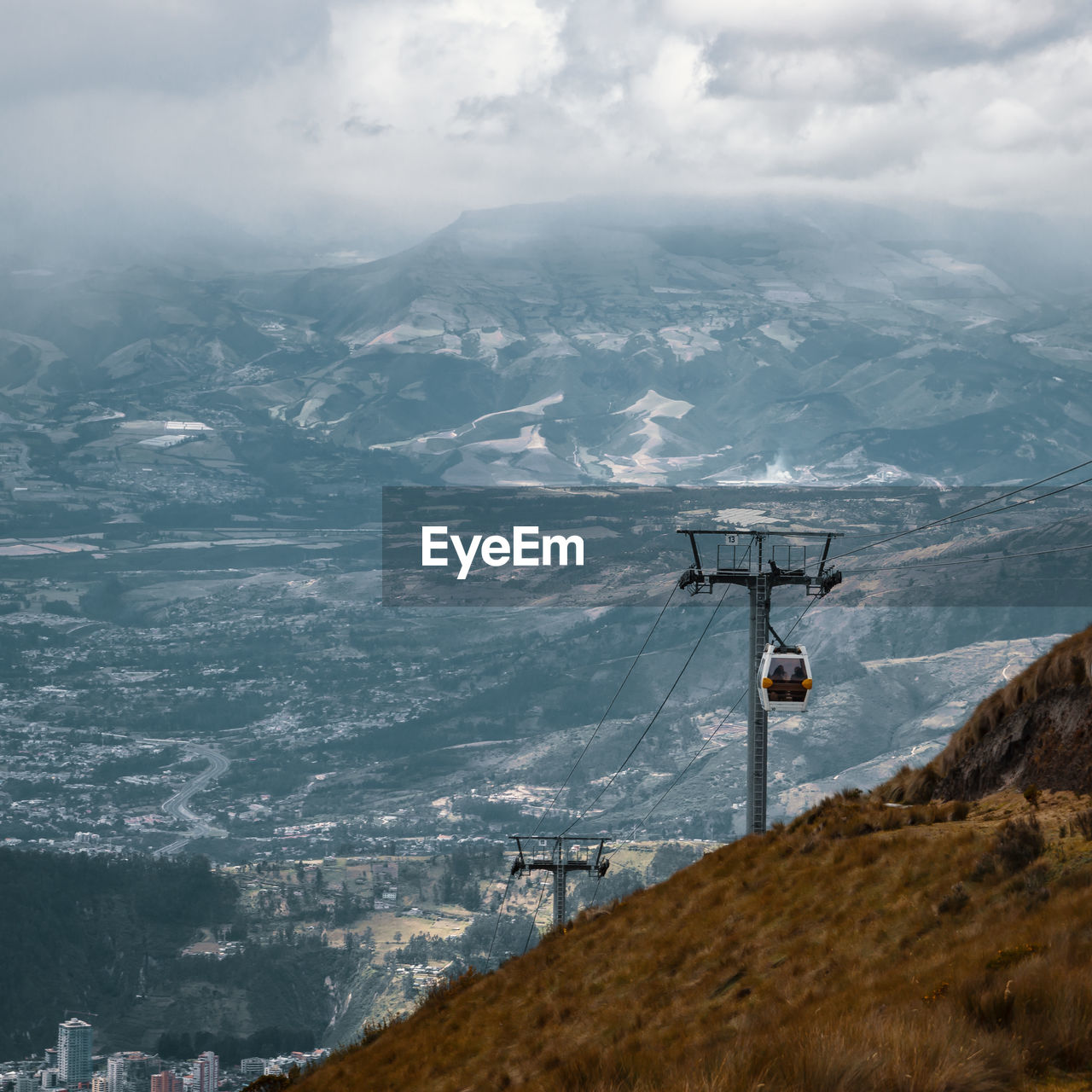 mountain, cloud - sky, sky, scenics - nature, beauty in nature, mountain range, nature, landscape, cable car, environment, day, overhead cable car, no people, tranquility, tranquil scene, technology, cable, connection, outdoors, electricity, snowcapped mountain