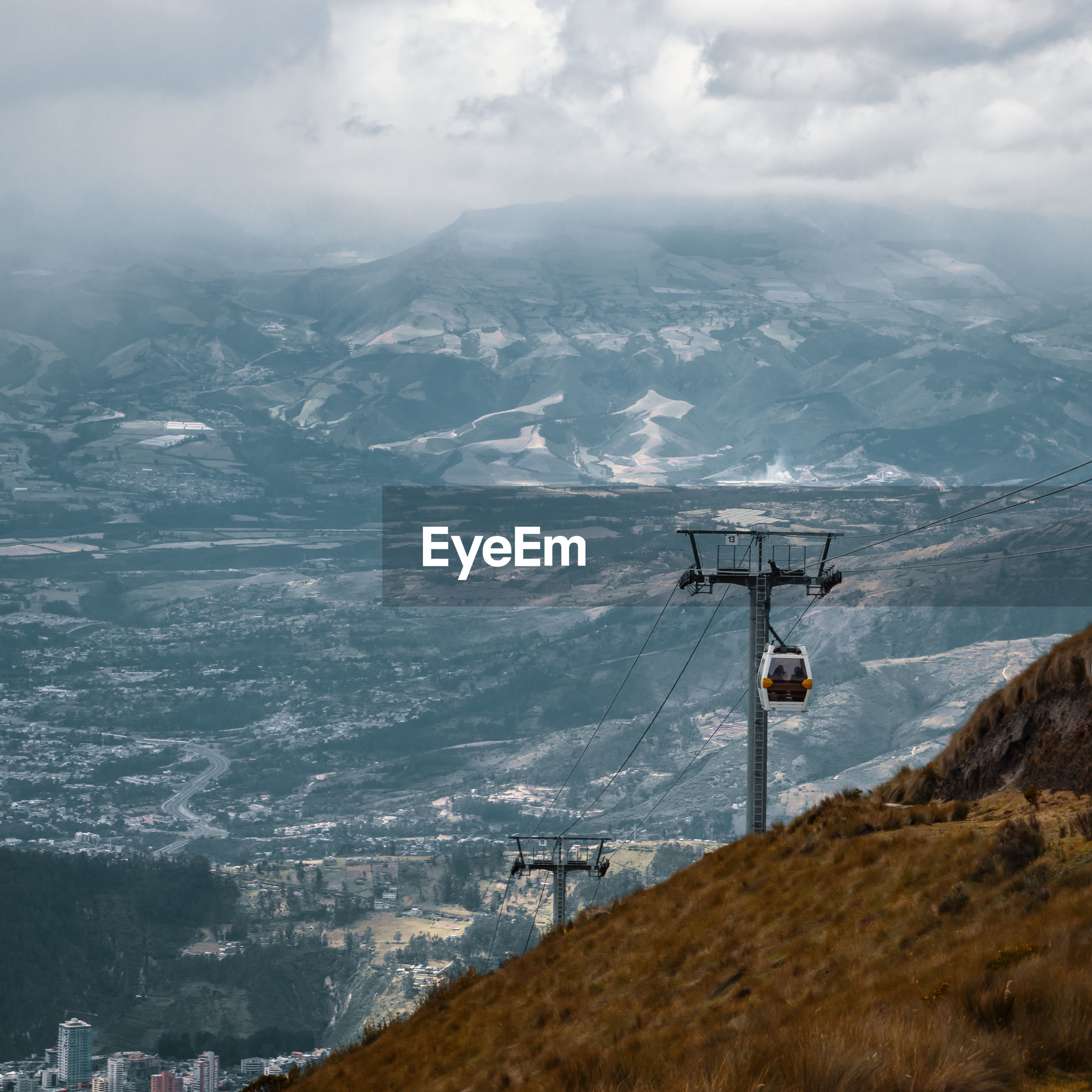 Cable car on mountains against sky