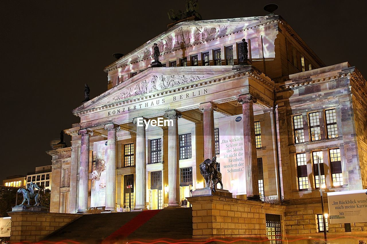 Low angle view of illuminated konzerthaus berlin against sky
