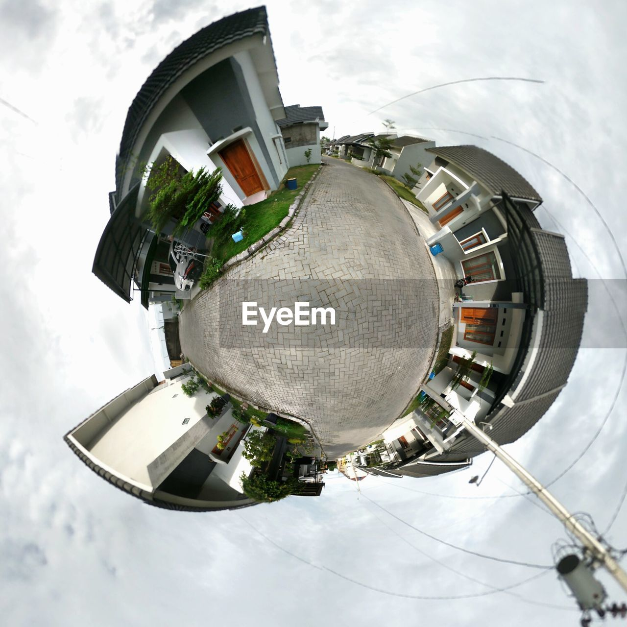 sky, low angle view, day, outdoors, fish-eye lens, no people, built structure, architecture, building exterior, planet earth