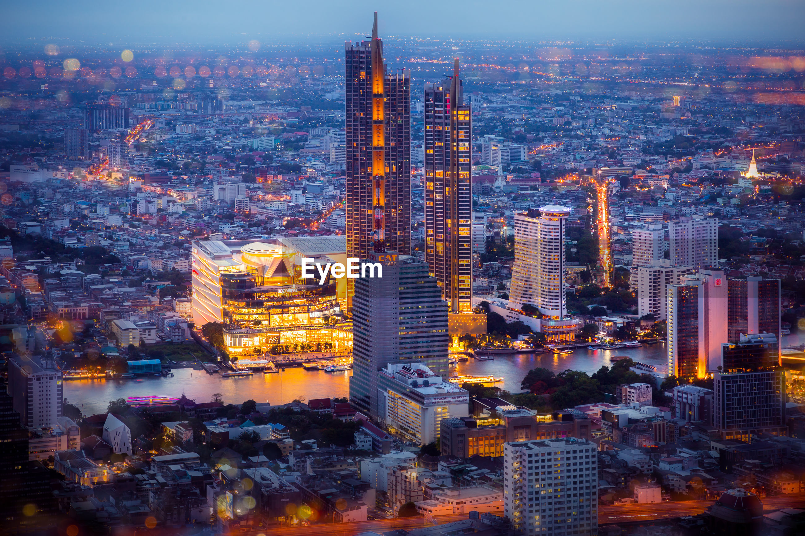 AERIAL VIEW OF CITY BUILDINGS AT DUSK