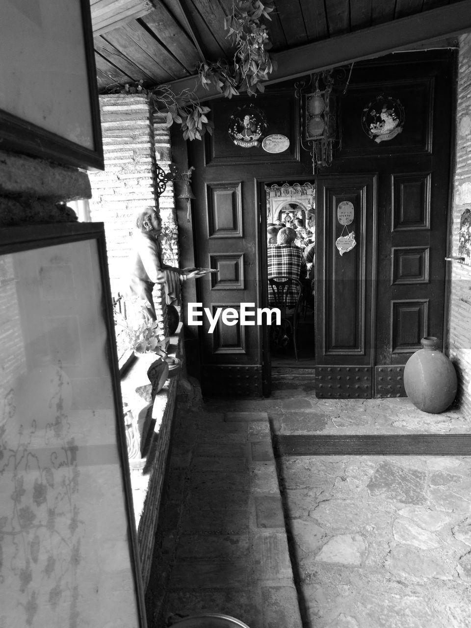 People seen through door