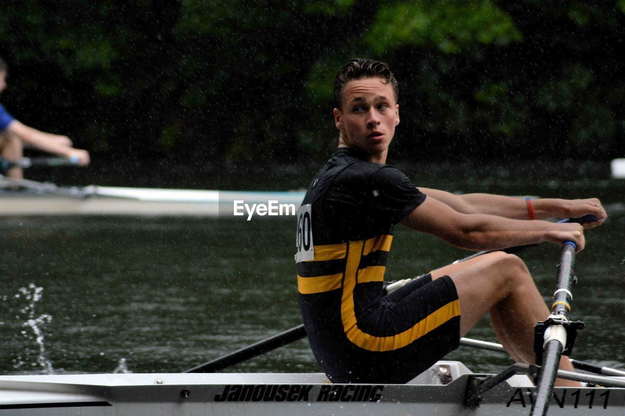 Teenager Rowing Boat During Race In River