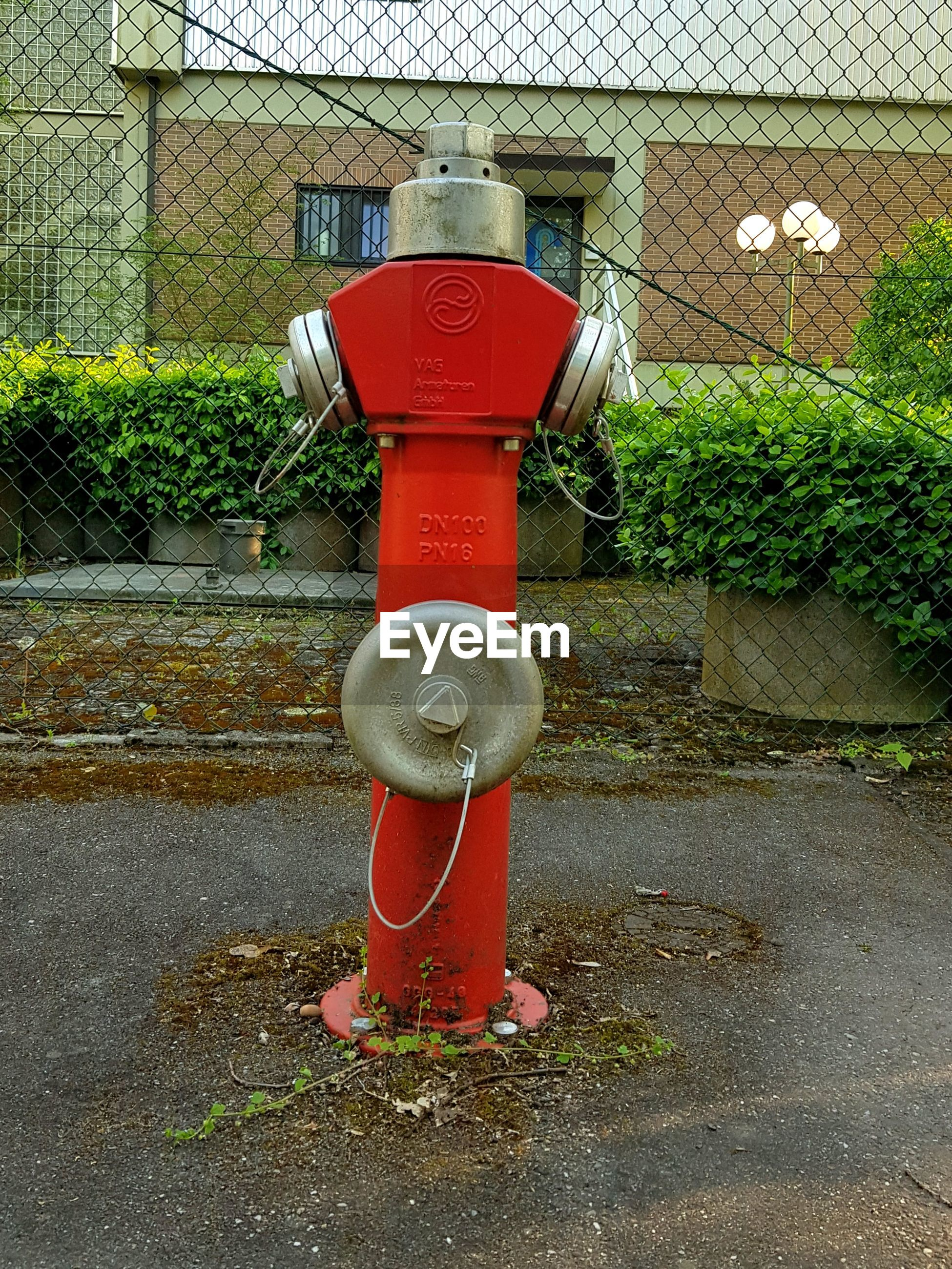 RED FIRE HYDRANT ON BUILDING