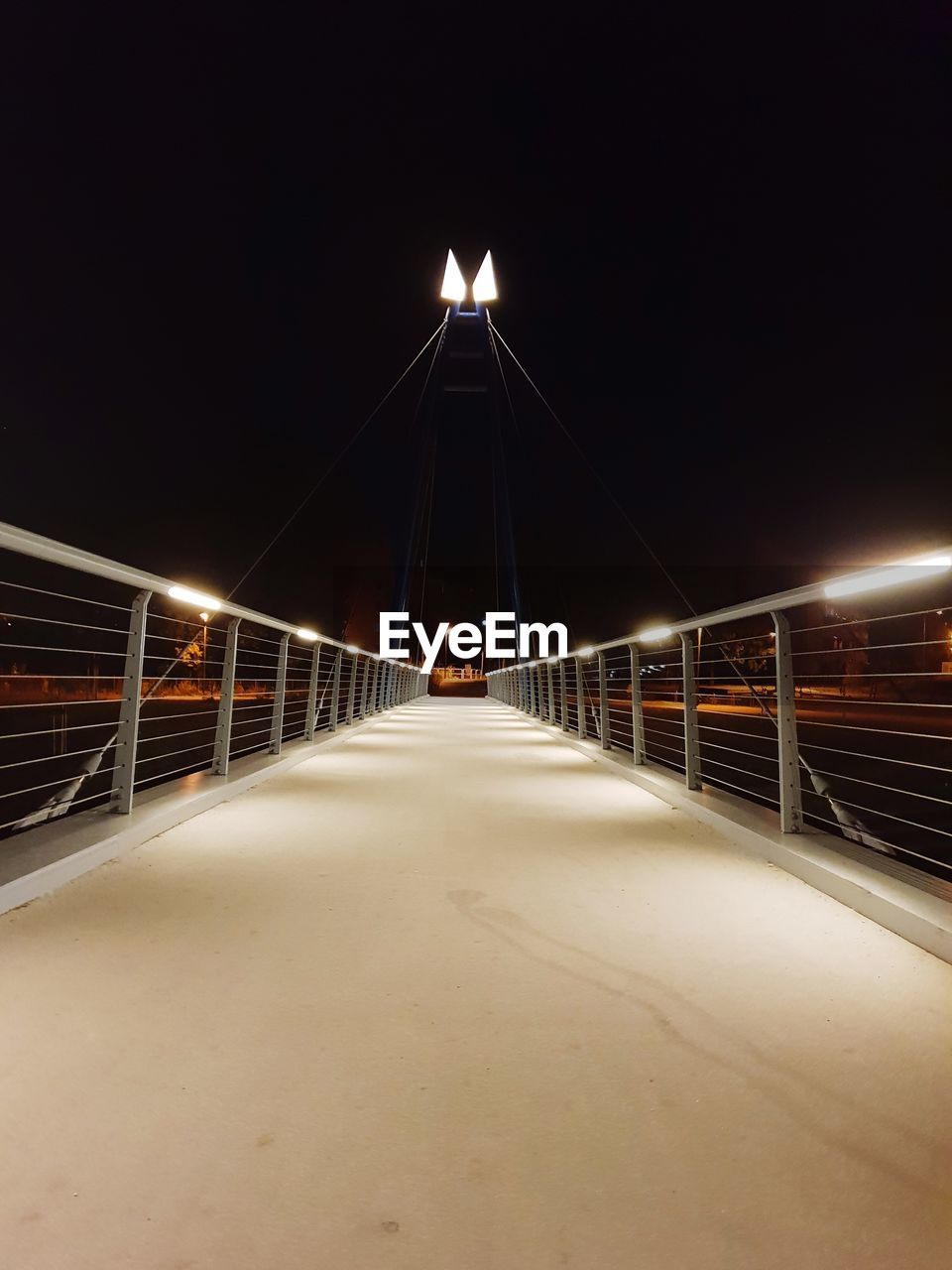 illuminated, night, architecture, the way forward, direction, built structure, transportation, lighting equipment, connection, sky, bridge, railing, bridge - man made structure, nature, no people, diminishing perspective, outdoors, city, glowing, motion, light