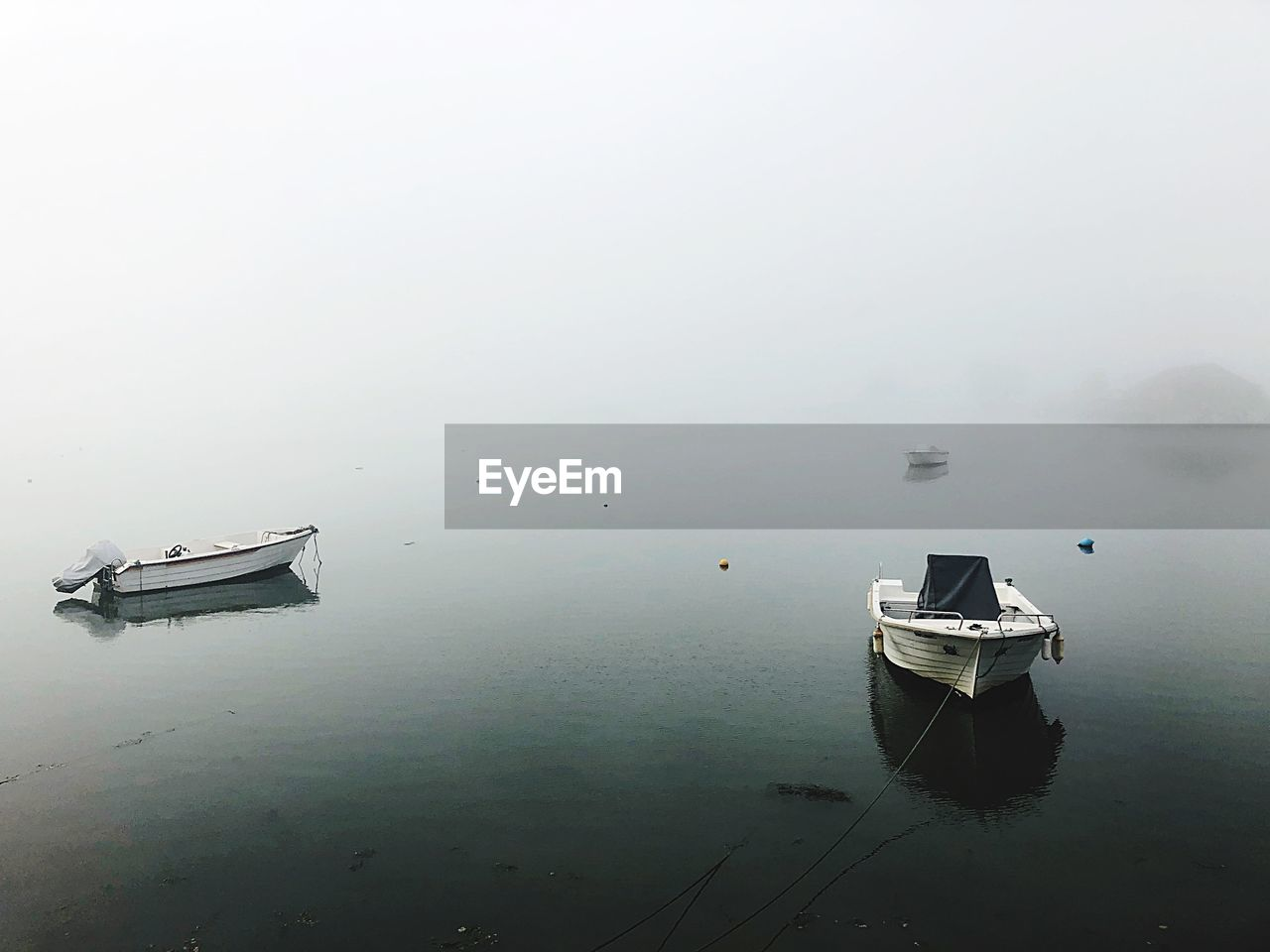 nautical vessel, water, fog, waterfront, tranquility, mode of transportation, scenics - nature, transportation, tranquil scene, moored, no people, reflection, nature, day, lake, beauty in nature, sky, outdoors, rowboat, anchored
