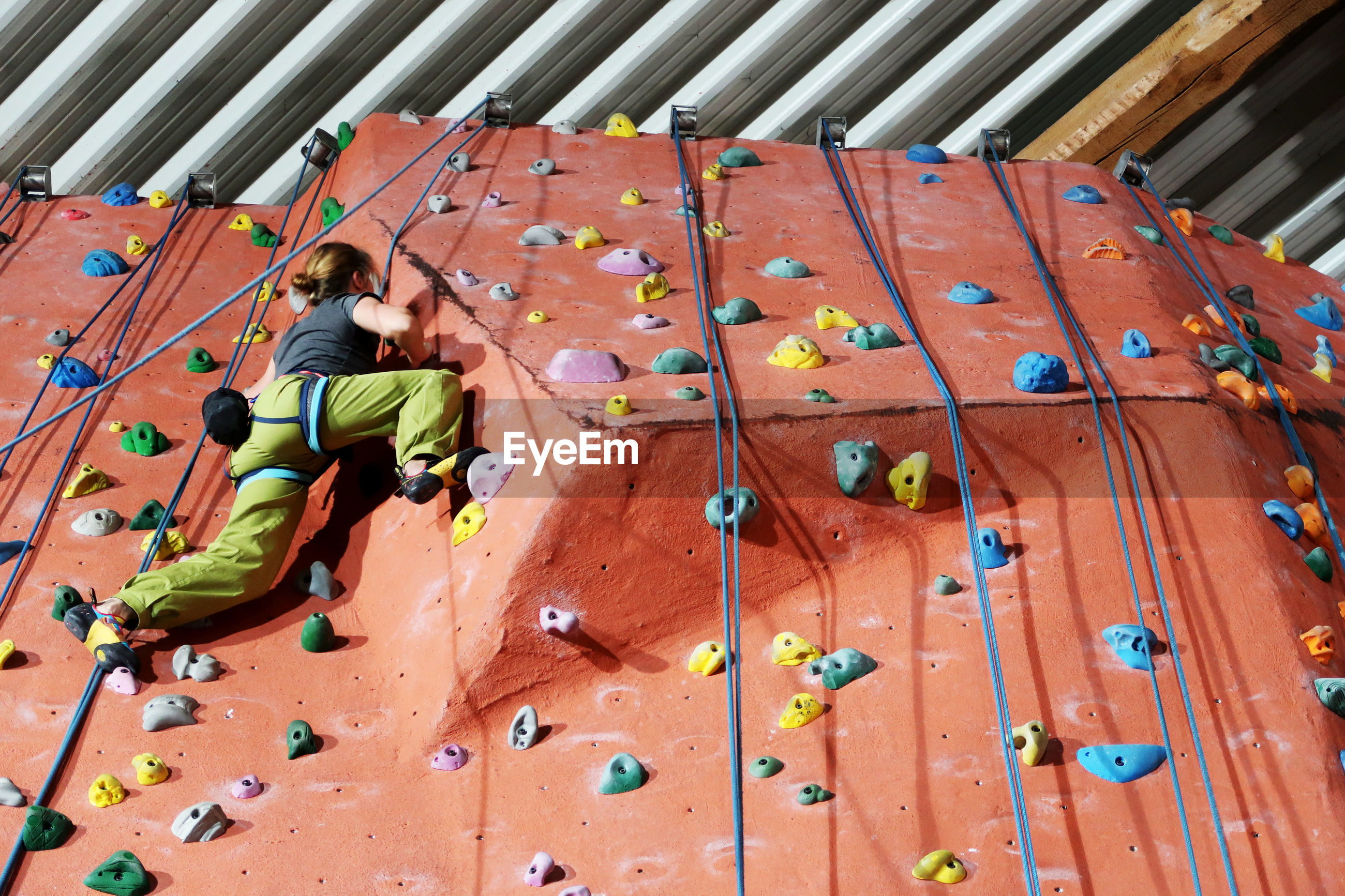 Low angle view of young women on climbing wall