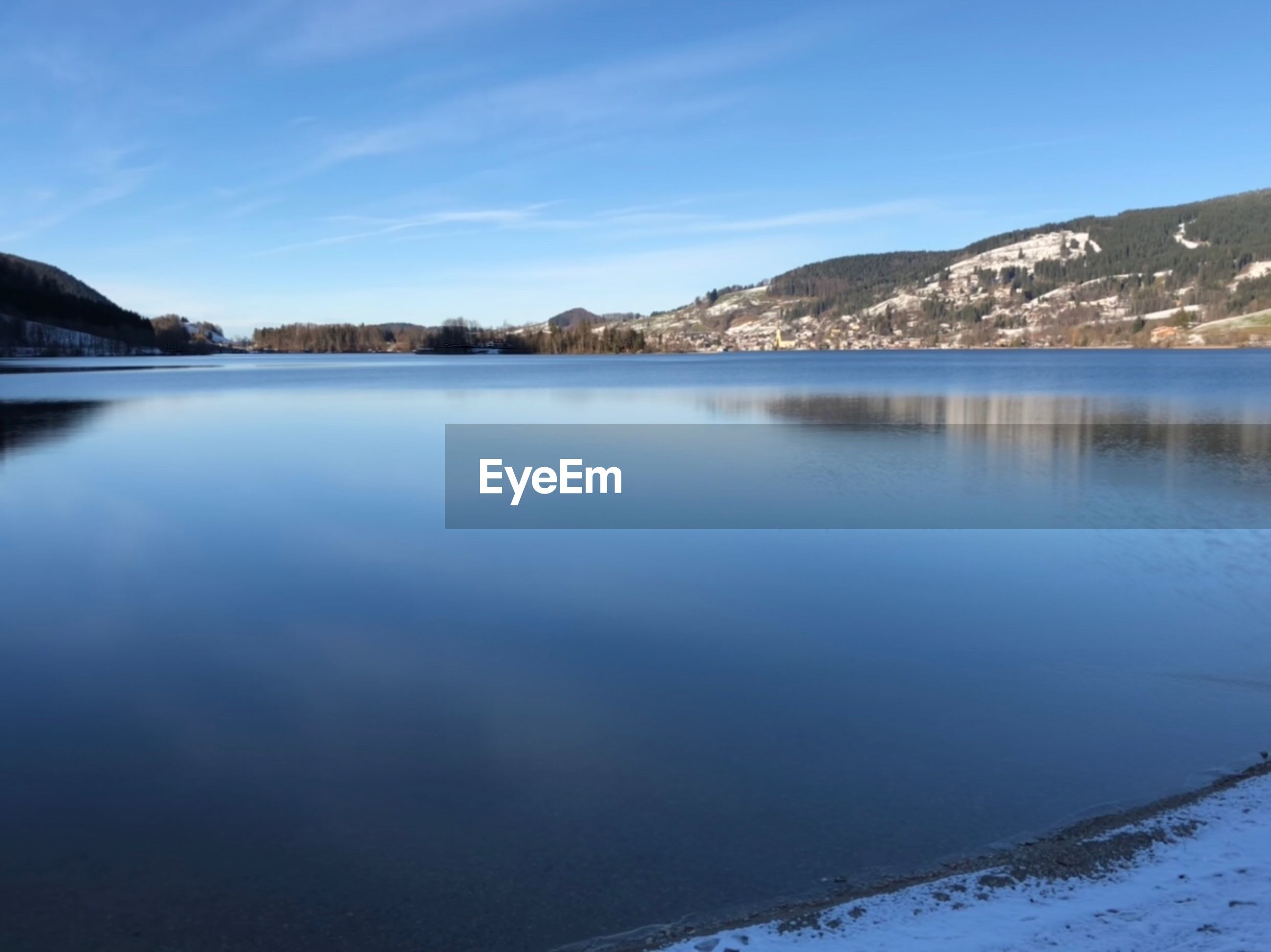 SCENIC VIEW OF LAKE AGAINST BLUE SKY