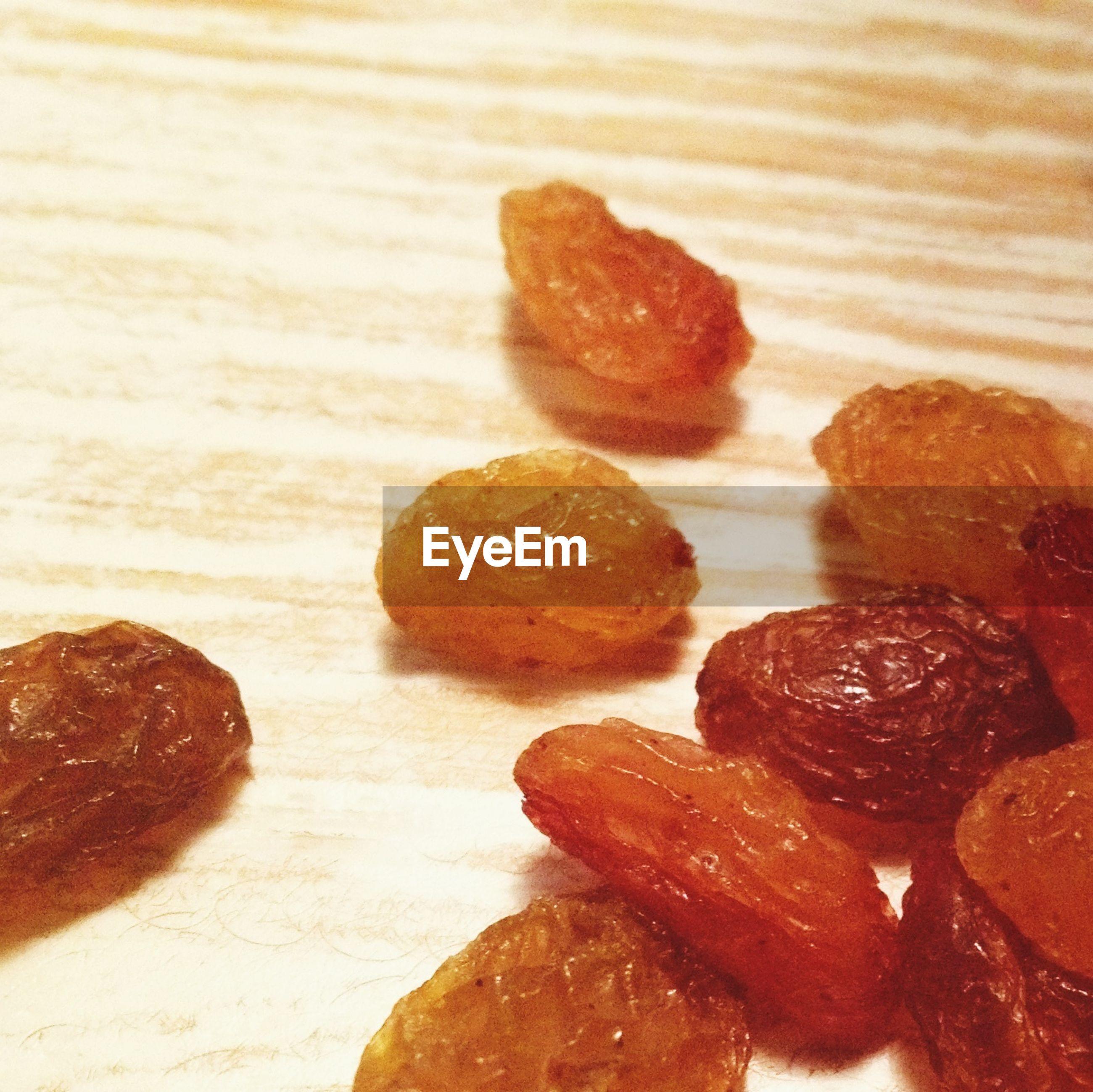 Raisins on wooden surface