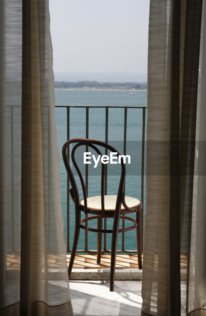 curtain, no people, sea, day, chair, table, indoors, sky, nature, water, close-up