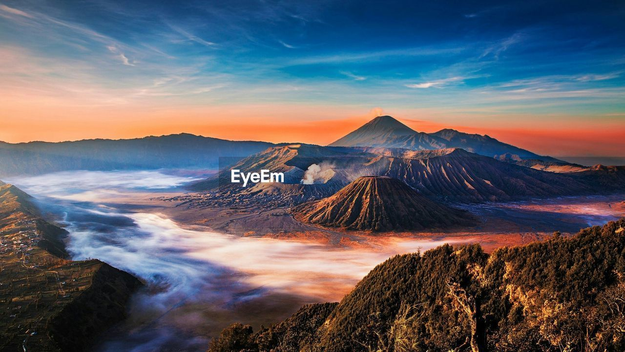 Scenic View Of Volcanic Landscape Against Sky During Sunset