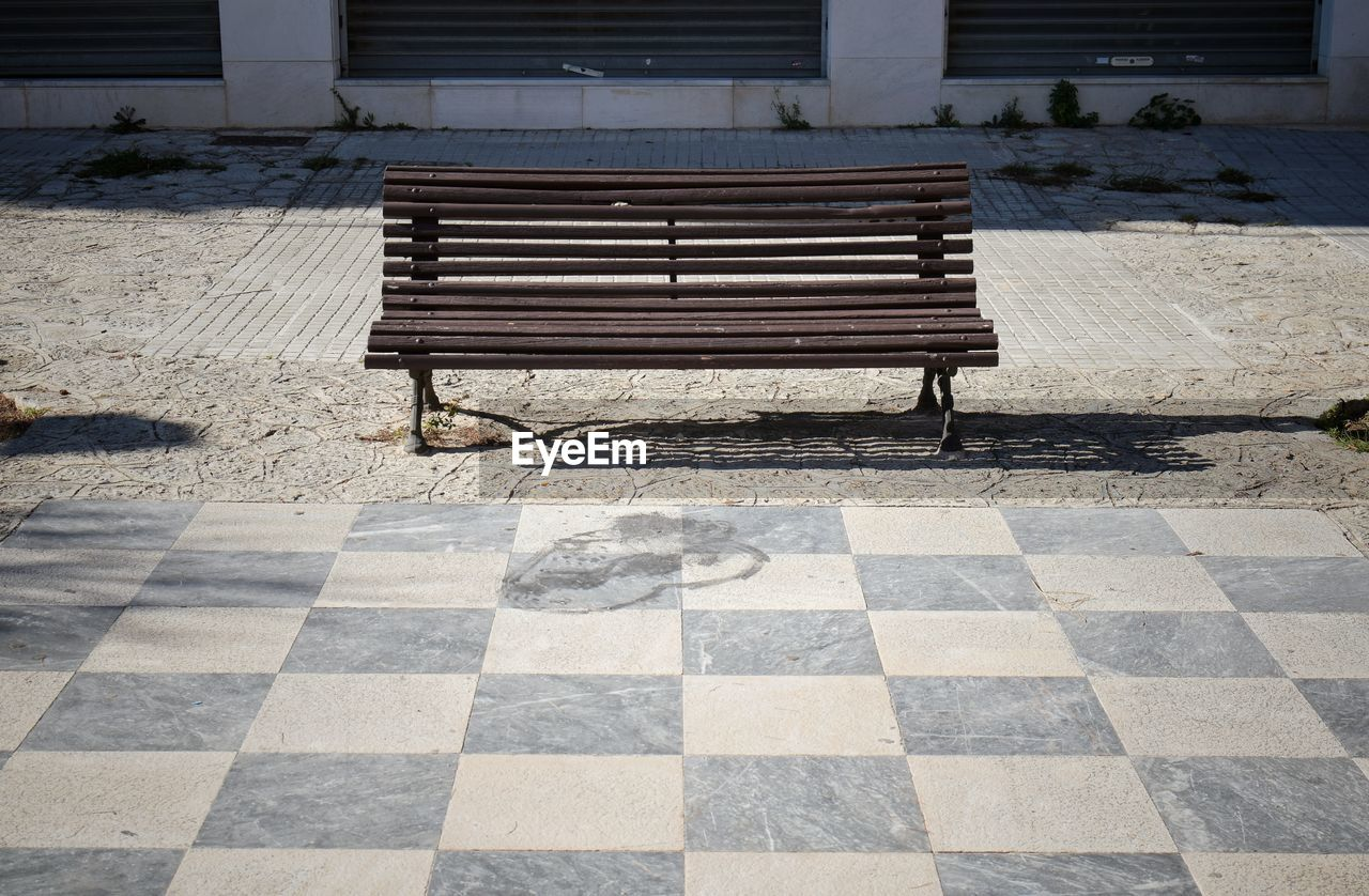 seat, absence, empty, bench, no people, architecture, pattern, day, nature, flooring, checked pattern, sunlight, outdoors, shadow, relaxation, park, built structure, footpath, tiled floor, tile, park bench