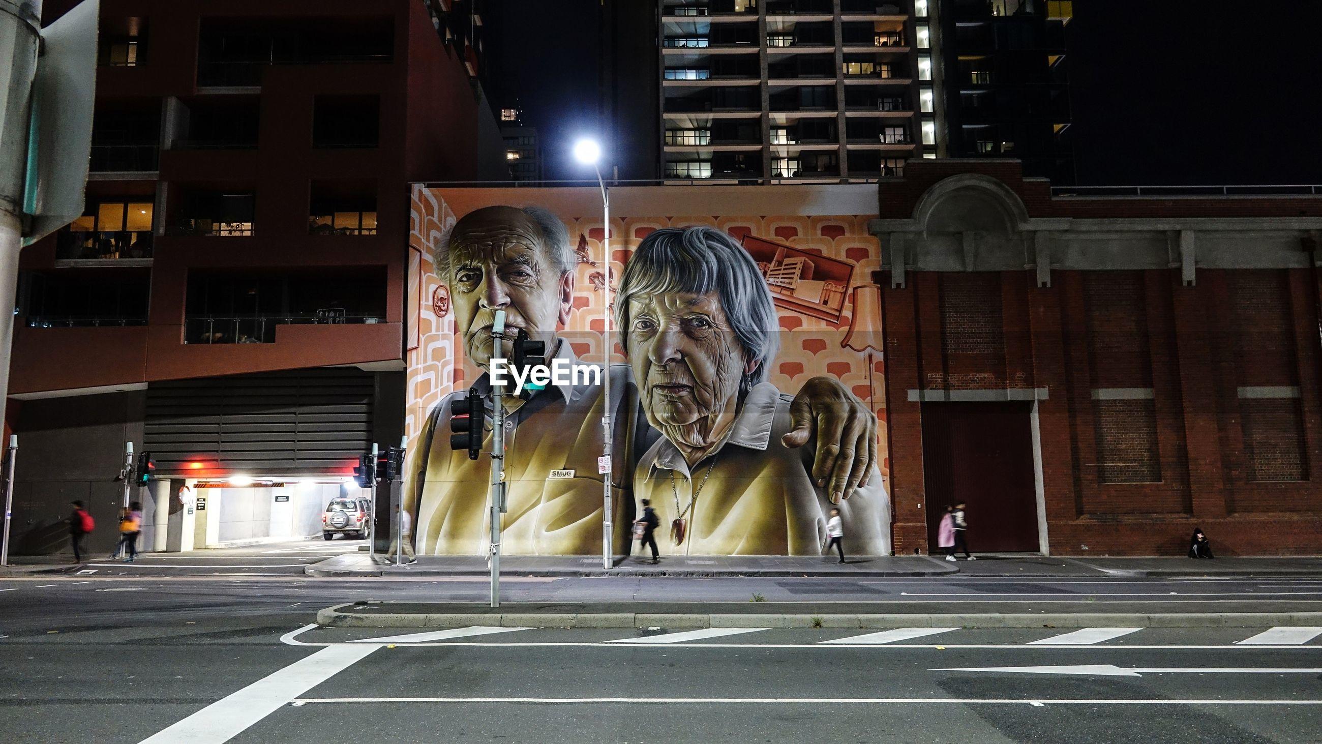 GRAFFITI ON BUILDING AT NIGHT