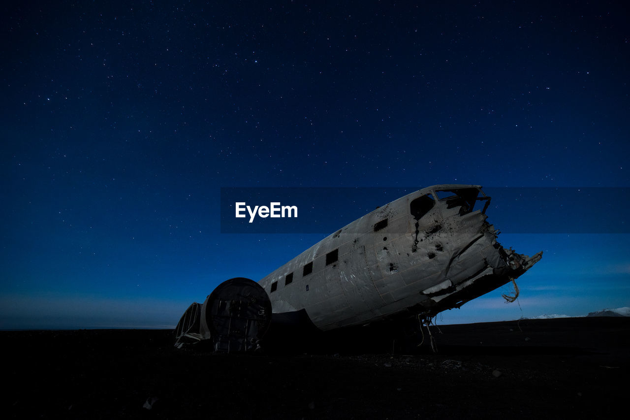 Abandoned Airplane Against Star Field At Night