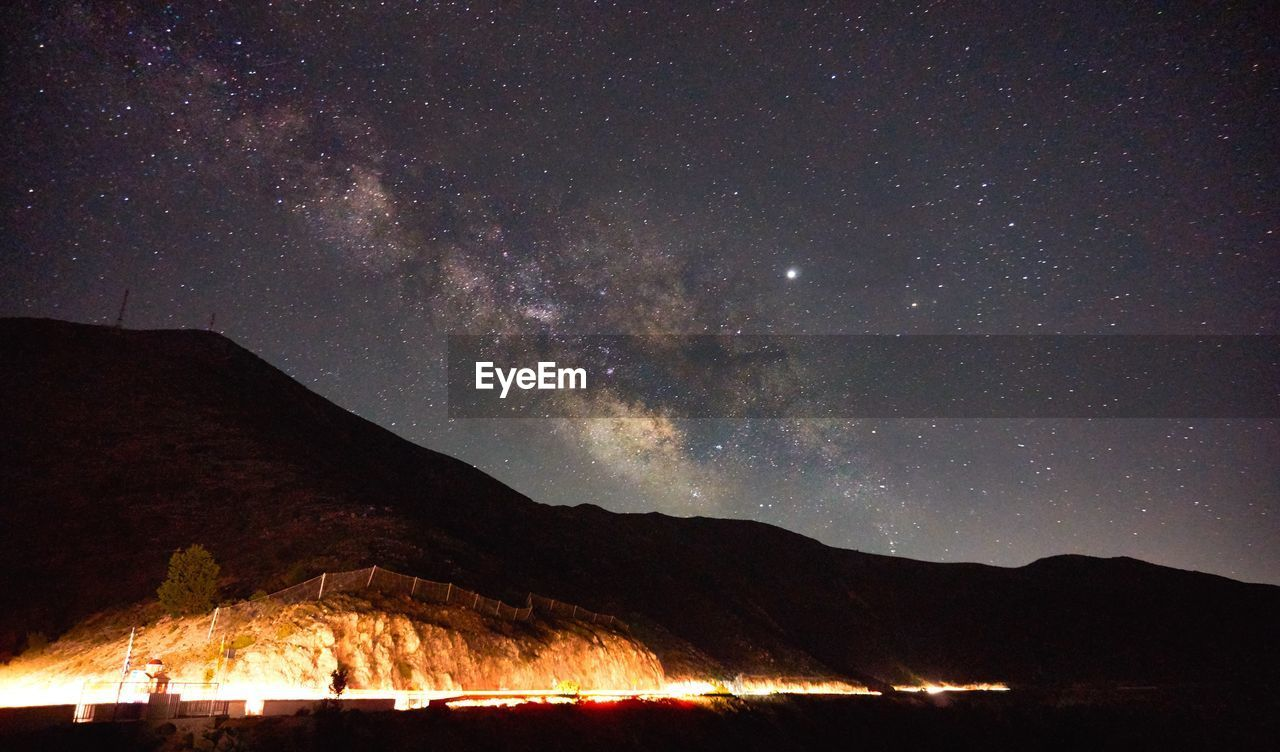 night, star - space, sky, scenics - nature, mountain, astronomy, beauty in nature, nature, space, galaxy, no people, star, tranquility, tranquil scene, flame, fire, star field, burning, outdoors, idyllic, milky way, bonfire