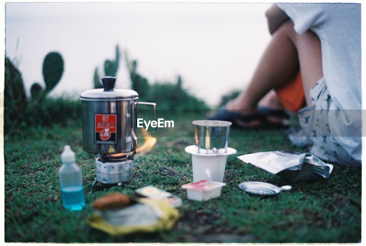 CAMPING EQUIPMENT ON GRASS WITH COPY SPACE